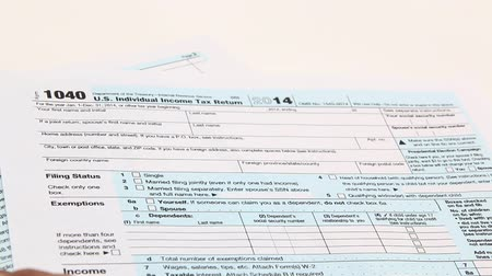 подпись : Income tax form and pen. Finance concept  1040 form