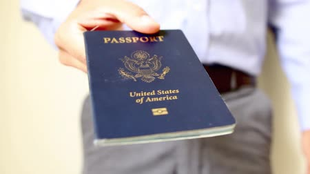 pas : Image of a persons hand holding a passport. travel concept Dostupné videozáznamy