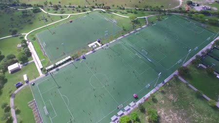 Areal view of soccer fields with people playing. drone Wideo