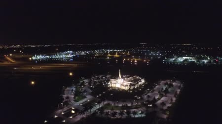 Night lights view over a religious temple. aerial Wideo