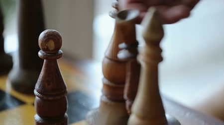 rook : Close-up process of playing chess. Bishop moving and Rook falling on the board