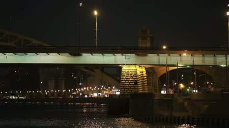 bridge man made structure : Bridge over the river night,Moscow.View from the river.On the bridge riding cars, illuminations and street lighting. Stock Footage