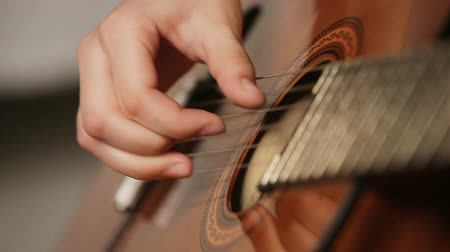 flamenco : Female hand playing on acoustic guitar. Close-up.Female hands on the strings of a guitar. Stock Footage