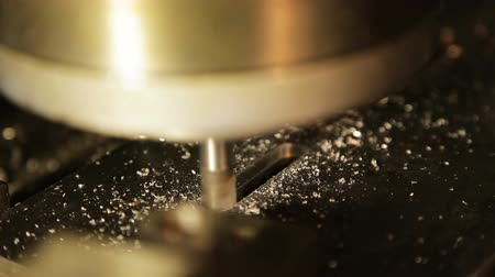 fitter : Turning lathe in action. Facing operation of a metal blank on turning machine with cutting tool.