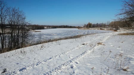 rastr : Winter landscape of the countryside, a frozen lake, trees covered with snow Dostupné videozáznamy