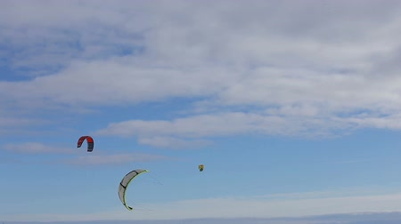 kiting : Parachute in the blue sky.Winter snowkiting on the winter field.