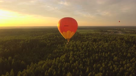 from air : Hot air balloons in the sky over a field in the countryside in the beautiful sky and sunset.