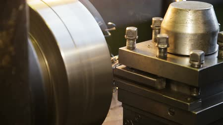 metal worker : Turning lathe in action.Facing operation of a metal blank on turning machine with cutting tool.