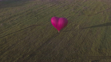 tej : Red balloon in the shape of a heart. Aerial view