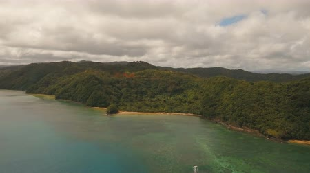 высота над уровнем моря : Aerial view: beach, tropical island, bay and lagoon. Tropical landscape sky, clouds and mountains rocks with rainforest. Aerial: Blue lagoon in the ocean. Aerial video.Seascape. 4K video. Travel concept. Aerial footage.