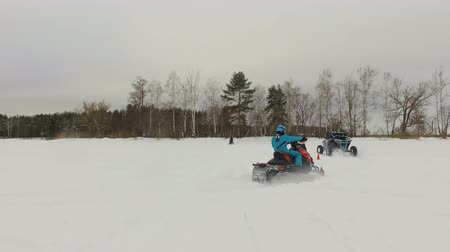 buggy car : Winter racing side-by-side vehicles. Rally on the buggy on the snow on a winter day. Racing in the SXS class. Buggy, sports car on rally. Off Road Series racing. 4K video