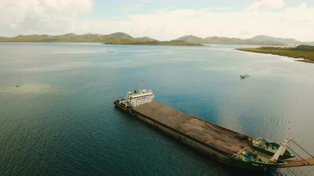ferry terminal : Cargo and passenger port with barges and cargo ships on tropical island. Aerial view:passenger ferry terminal Dapa city .Ferries for transport vehicles and passengers in the port. Philippines, Siargao. 4K video.Travel concept. Aerial footage.