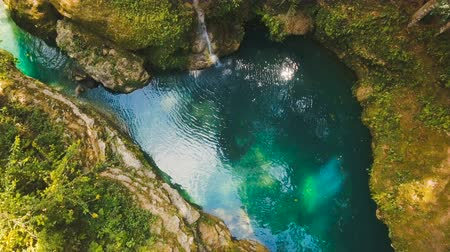 cebu : Beautiful waterfall in green forest in jungle. Aerial view:tropical rain forest with waterfall.Waterfall with natural swimming pool in a mountain river canyon. Philippines, Cebu. 4K video. Travel concept. Aerial footage.