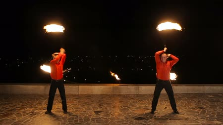 fişekçilik : Men twist fiery circles on a fire show.Men does a fire performance.Fire show amazing at night.