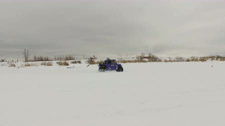 atv : Winter racing side-by-side vehicles. Rally on the buggy on the snow on a winter day. Racing in the SXS class. Buggy, sports car on rally. Off Road Series racing. 4K video