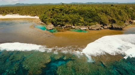 siargao : Tropical beach with natural rock pools in the Siargao Island. Aerial view Magpupungko natural rock pools. 4K, Travel concept, Aerial footage.