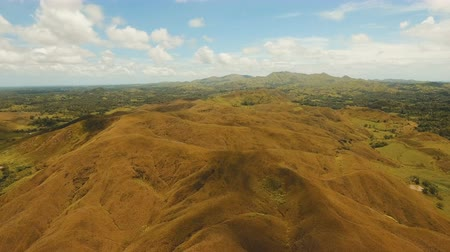 montanhoso : Aerial view Beautiful hilly mountains landscape. Big hills on a tropical island Bohol , Philippines. 4K video. Travel concept. Aerial footage.