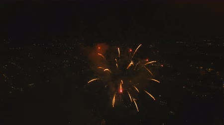 jiskří : Aerial view Beautiful fireworks video from the drone in the night sky on celebration. Sparks. Fireworks are a class of explosive pyrotechnic devices used for aesthetic and entertainment purposes. Aerial footage, 4k.