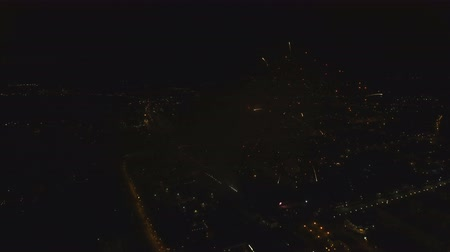 rockets : Aerial view Beautiful fireworks video from the drone in the night sky on celebration. Sparks. Fireworks are a class of explosive pyrotechnic devices used for aesthetic and entertainment purposes. Aerial footage, 4k.