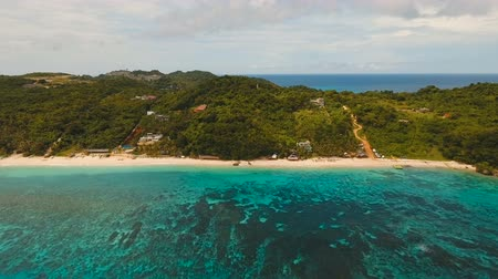 boracay : Aerial view of beautiful tropical island with white sand beach, hotels and tourists. Tropical lagoon with turquoise water and white sand. Beautiful sky, sea, beach, resort. Beautiful tropical beach of Boracay island. Seascape: Ocean and beautiful beach pa