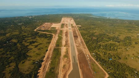 landing field : Construction of a new airport terminal on Panglao. Aerial view Modern airport terminal construction site. Construction of a landing strip on the island of Bohol, Philippines. Landing strip. 4K video. Travel concept. Aerial footage. Stock Footage