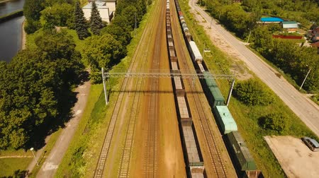 dízel : Freight train with cisterns and containers on the railway. Aerial view Container Freight Train, Locomotive in the countryside, Railway and highway. 4K, flying video, aerial footage.
