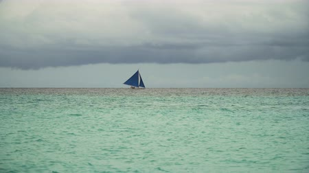 boracay : Sailing boat on sea. Sailing ship yachts with blue sails in the ocean. Sailing ship yachts in the sea. Philippines, Boracay. 4K video. Travel concept.