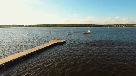 motor boat : Helicopter landing on the pier on the lake. Aerial footage, 4k.