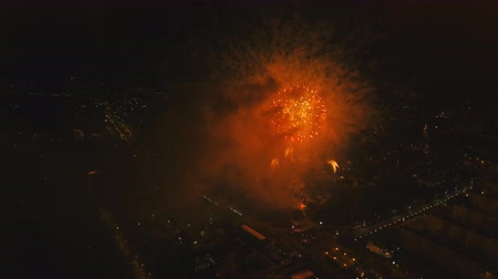 wybuch : Aerial view Beautiful fireworks video from the drone in the night sky on celebration. Sparks. Fireworks are a class of explosive pyrotechnic devices used for aesthetic and entertainment purposes. Aerial footage, 4k.
