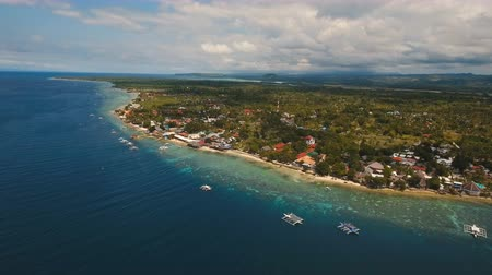 cebu : Aerial view of beautiful tropical island with white sand beach, boats, hotels and tourists. Tropical lagoon with turquoise water and white sand. Beautiful sky, sea, beach,mountains, resort. Seascape: Ocean and beautiful beach paradise. Beautiful view of a Stock Footage