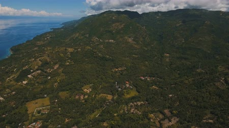 cebu : Mountains with rainforest covered with green vegetation and trees on the tropical island, landscape. Aerial view: Mountains and hills with wild forest. Hillside rainforest and jungle. Philippines, Cebu. 4K video. Aerial footage.