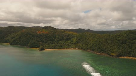 primeval : Aerial view: beach, tropical island, bay and lagoon. Tropical landscape sky, clouds and mountains rocks with rainforest. Aerial: Blue lagoon in the ocean. Aerial video.Seascape. 4K video. Travel concept. Aerial footage.