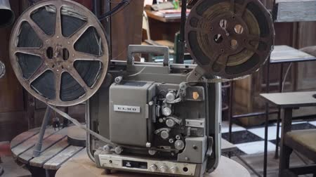 taŚma filmowa : Old fashioned cinema projector. Vintage Movie projector with the film. Wideo