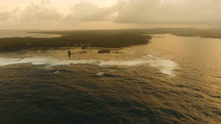 surfer paradise : Viewpoint in the ocean at Cloud Nine surf point at sunset, Siargao island , Philippines. Aerial view raised wooden walkway for surfers to cross the reef of siargao island to cloud 9 surf break mindanao. Siargao islands famous surf break cloud 9. Flying ov