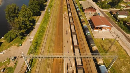 dízel : Freight train with cisterns and containers on the railway. Aerial view Container Freight Train, Locomotive to the railway station. 4K, flying video, aerial footage.
