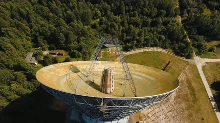 observatory : Radio astronomy observatory located in the forest. Aerial view Giant radio telescop, Large satellite dish.drone footage, 4k. Stock Footage