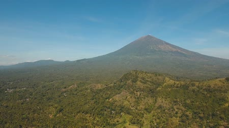 bali : Aerial view volcano Agung, mountain, mountains covered with green forest, trees with sky and clouds. Slopes of the mountains are covered with forest in Asia. Bali,Indonesia. 4K video. Travel concept. Aerial footage.