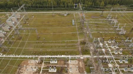 tvořit : Aerial view Power plant, transformation station, cables and wires. High voltage electric power substation. Electrical power transformer in high voltage substation, 4K, aerial footage.