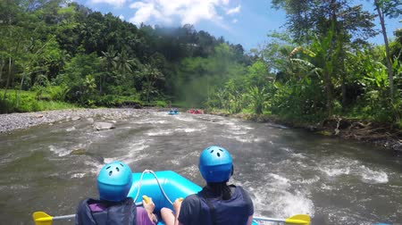 いかだ : Rafting in the canyon on Balis mountain river. Group of traveler in the inflatable rafting on the river, extreme and fun sport