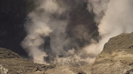 volkan : Crater with active volcano and smoke in East Jawa, Indonesia. Volcano crater Mount Gunung Bromo is an active volcano,Tengger Semeru National Park. 4K video. Stok Video