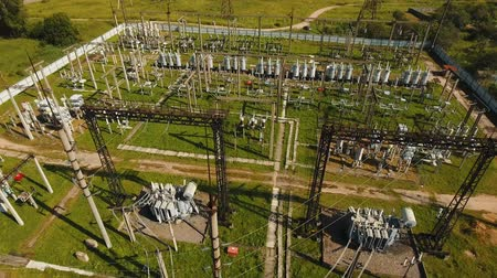 izolace : Aerial view Power plant, transformation station, cables and wires. High voltage electric power substation. Electrical power transformer in high voltage substation, 4K, aerial footage.