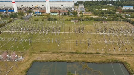 yalıtım : Aerial view Power plant, transformation station, cables and wires. High voltage electric power substation. Electrical power transformer in high voltage substation, 4K, aerial footage.