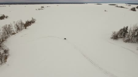 atv : Winter off-road racing side-by-side vehicles. Aerial view: Rally on the buggy on the snow on a winter day. Racing in the SXS class. Buggy, sports car on rally. Off Road Series racing. 4K video, drone footage.