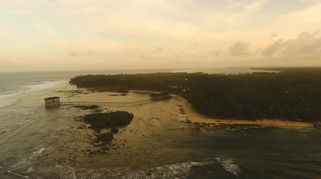 nove : Viewpoint in the ocean at Cloud Nine surf point at sunset, Siargao island , Philippines. Aerial view raised wooden walkway for surfers to cross the reef of siargao island to cloud 9 surf break mindanao. Siargao islands famous surf break cloud 9. Flying ov
