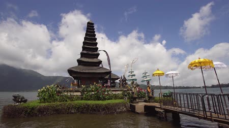 bratan : Cinemagraph - Hindu Temple Pura Ulun Danu Bratan, on Bratan lake. Motion Photo. Balinese, old hindu architecture, Bali Architecture, Ancient design. 4K video. Travel concept.