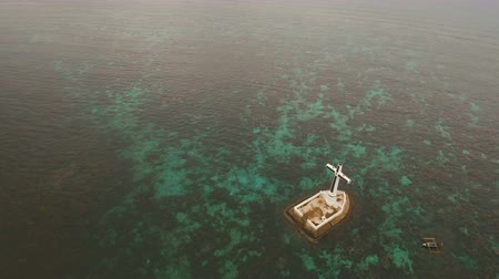 mindanao : Aerial view Sunken Cemetery cross in Camiguin Island, Philippines. Large crucafix marking the underwater sunken cemetary of the coast of camiguin island near mindanao in the Philippines. Catholic cross in the water. The Sunken Cemetery marks the swept rem