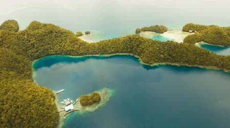 grande : Aerial view: Bucas Grande Island, Sohoton Cove. Philippines. Tropical sea bay and lagoon, beach. Tropical landscape hill, clouds and mountains rocks with rainforest. Azure water of lagoon. Shore Landscape Bay. Aerial video.Seascape. 4K video. Travel conce