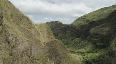 bitkiler : Aerial view of mountains covered with green vegetation, trees in vicinity volcano Pinatubo. Slopes of mountains, sky and clouds. Cordillera region. Luzon, Philippines.