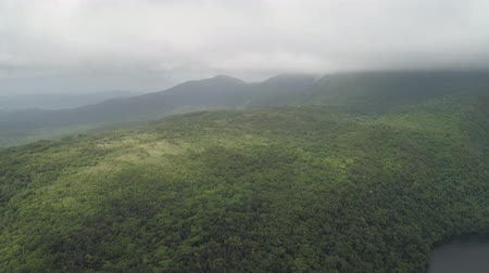 kraj : Aerial view of mountains covered forest, trees in cloudy weather, Bulusan Volcano. Luzon, Philippines. Slopes of mountains with evergreen vegetation. Mountainous tropical landscape.