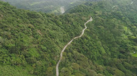 luzon : Mountain curve is a road passing along the slopes of mountains and hills covered with green forest and vegetation. Philippines, Luzon.